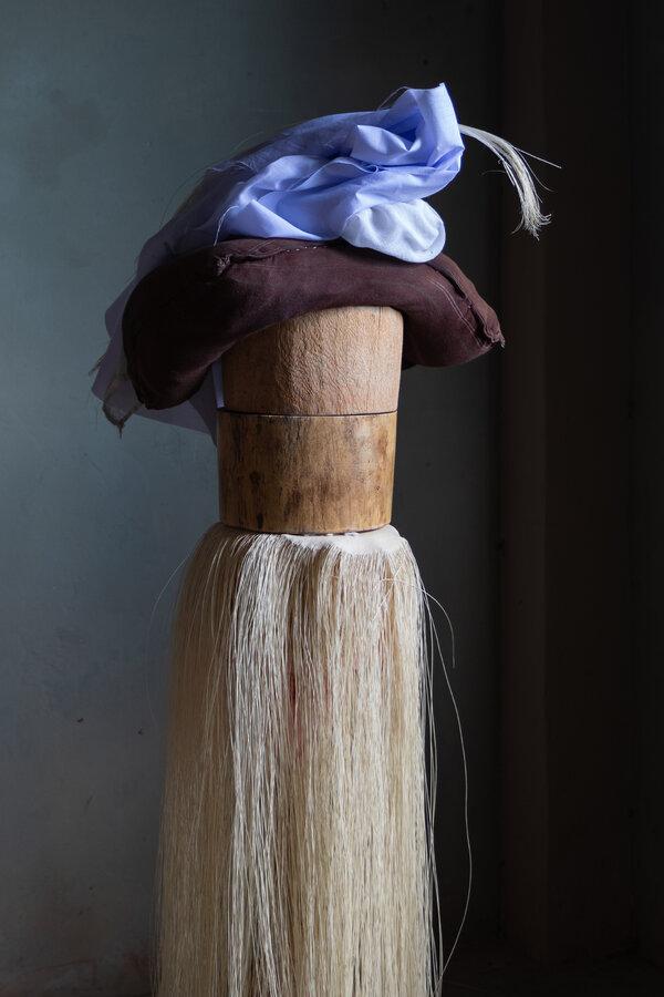 在編織過程中的頂級(superfino)帽。